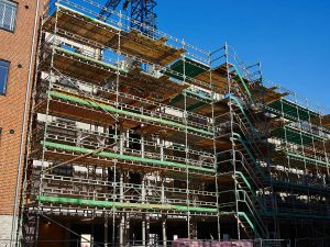Modern construction site with scaffold platform system with a clear blue sky background